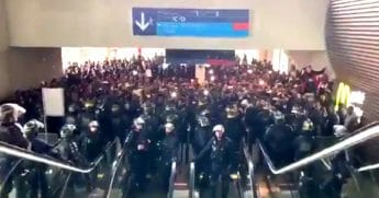 Hundreds of illegal immigrants face off against police officers in riot gear at France's Charles de Gaulle Airport.