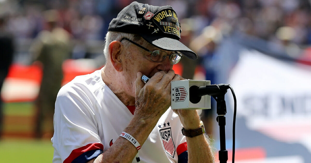 "World War II veteran ""Harmonica Pete"" DuPre performs the national anthem before a soccer match between the U.S. Women's National Team and Mexico."