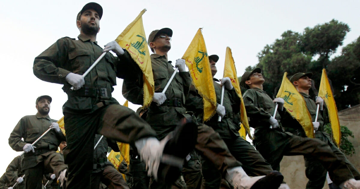 In this Nov. 12, 2010 file photo, Hezbollah fighters parade during the inauguration of a new cemetery for their fighters who died in fighting against Israel, in a southern suburb of Beirut, Lebanon. (Hussein Malla / AP Photo)