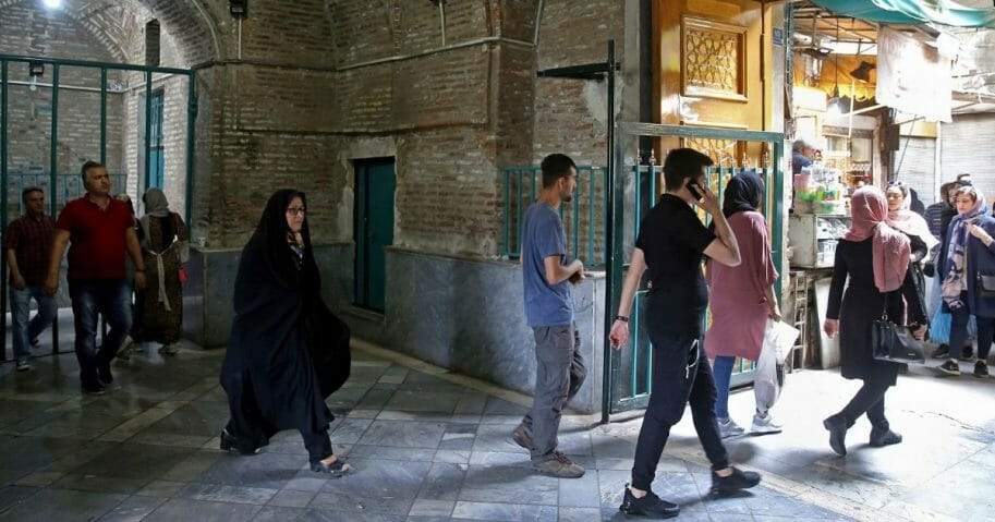 Shoppers stroll through the old main bazaar in Tehran, Iran, on May 8, 2019. The U.S. withdrew from the the 2015 nuclear deal and restored sanctions on Iran.
