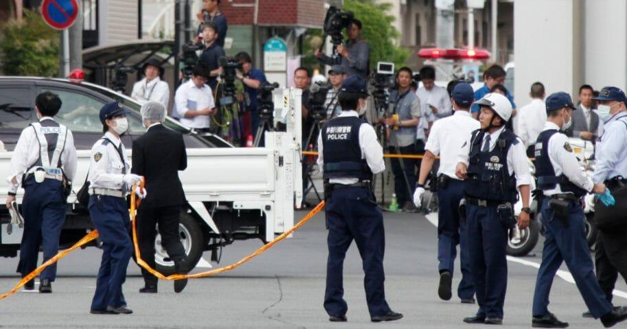 Police officers work at the scene where a man wielding a knife attacked commuters in Kawasaki, near Tokyo on May 28, 2019. (Koji Sasahara / AP Photo)