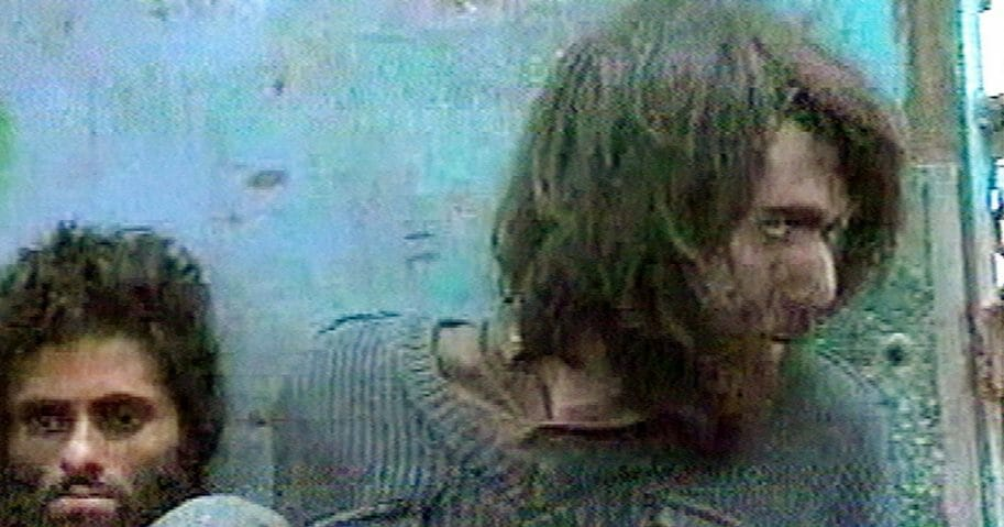 This image made from television footage made in Mazar-i-Sharif, Afghanistan, Saturday Dec.1, 2001, shows John Walker Lindh at right, claiming to be an American Taliban volunteer calling himself Abdul Hamid. Man at left is unidentified. (APTN / AP Photo)