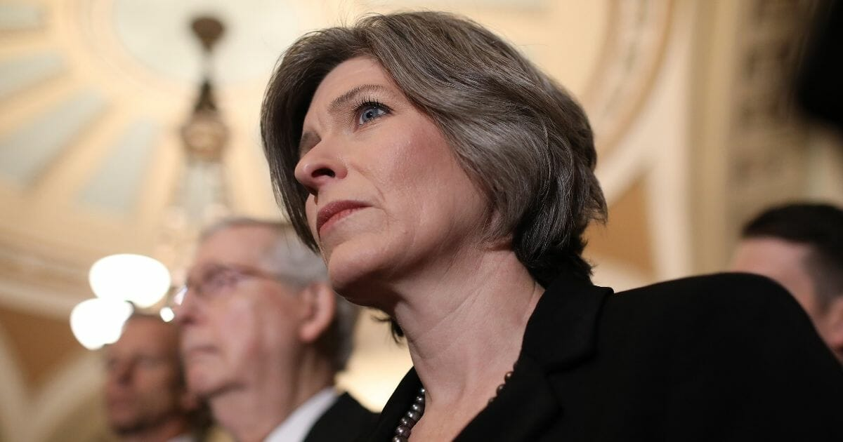 Sen. Joni Ernst listens to a reporter's question following the Republican policy luncheon on Feb. 26, 2019, in Washington, D.C.