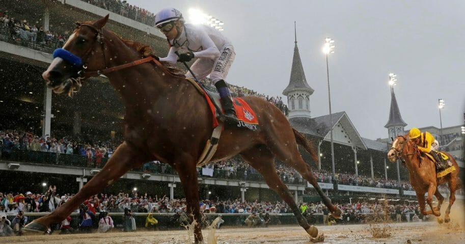 Mike Smith rides Justify to victory in the 144th running of the Kentucky Derby at Churchill Downs on May 5, 2018.