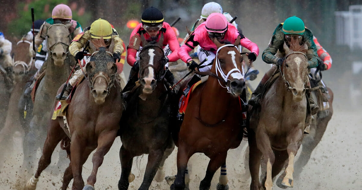 Country House, ridden by jockey Flavien Prat; War of Will, ridden by Tyler Gaffalione; Maximum Security, ridden by Luis Saez; and Code of Honor, ridden by John Velazquez, fight for position in the final turn of the 145th running of the Kentucky Derby.