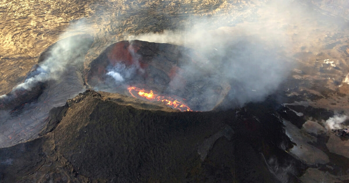 In this Sunday, Aug. 5, 2018 aerial photo provided by the U.S. Geological Survey, lava from the last active eruption site on Hawaii's Kilauea volcano is shown near Pahoa, Hawaii.