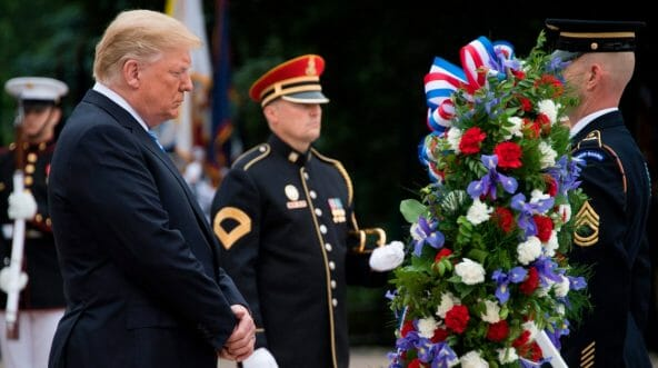 President Donald Trump lays a wreath at the Tomb of the Unknown Soldier.