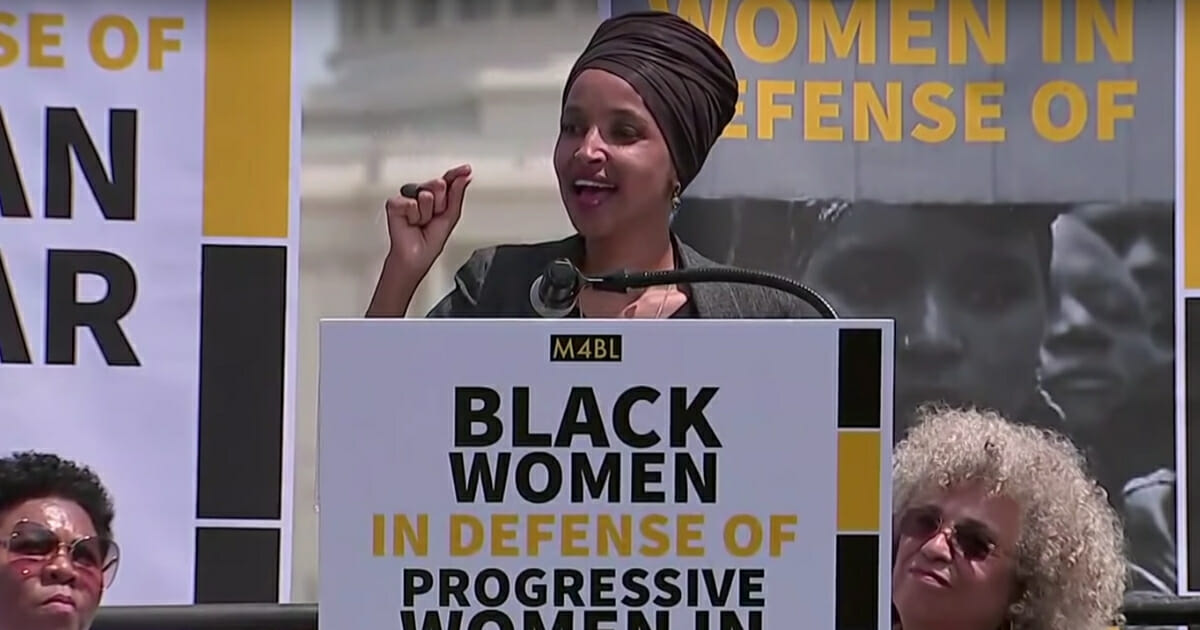 """Rep. Ilhan Omar speaks at a """"Black Women"""" rally Tuesday, April 30, in Washington, D.C."""