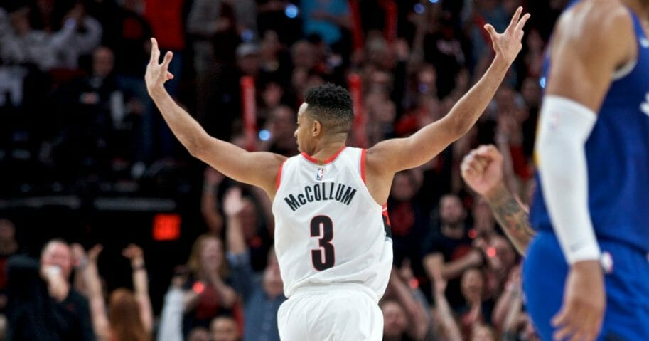 Portland Trail Blazers guard CJ McCollum reacts after making a three-point basket against the Denver Nuggets during Game 3 on Friday, May 3, 2019, in Portland.