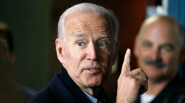 Former vice president and Democratic presidential candidate Joe Biden interacts with a supporter during a campaign stop at the Community Oven restaurant in Hampton, N.H., on Monday, May 13, 2019.