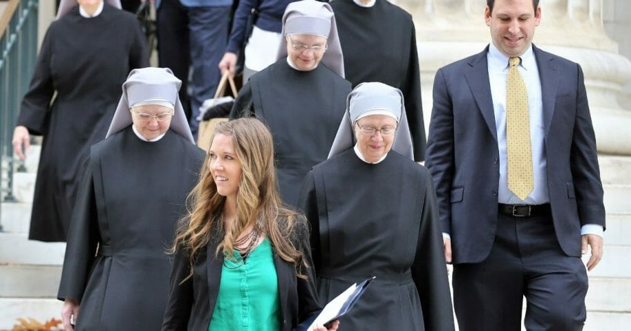 Members of the Little Sisters of the Poor are pictured leaving a Denver federal courthourse in a December 2014 file photo.