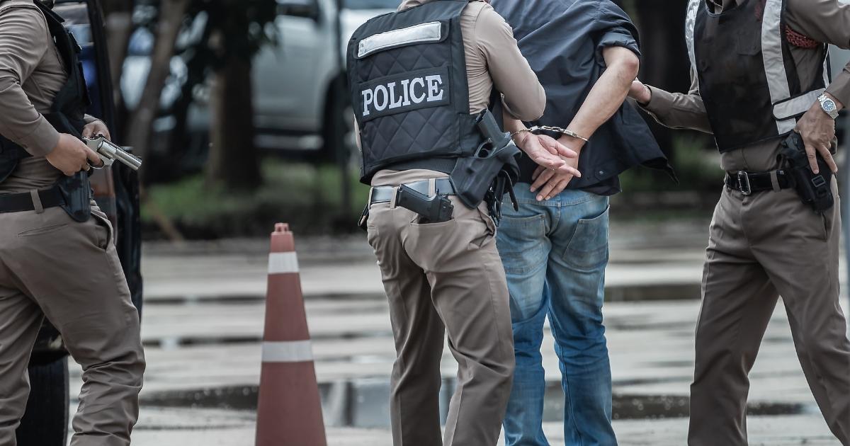 Police officers making arrest.