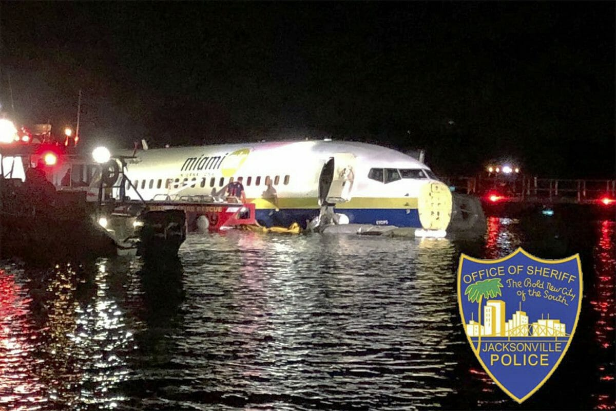 Authorities work at the scene of a plane in the water in Jacksonville, Florida, Friday, May 3, 2019. Officials say a charter plane traveling from Cuba to north Florida ended up in a river at the end of a runway.