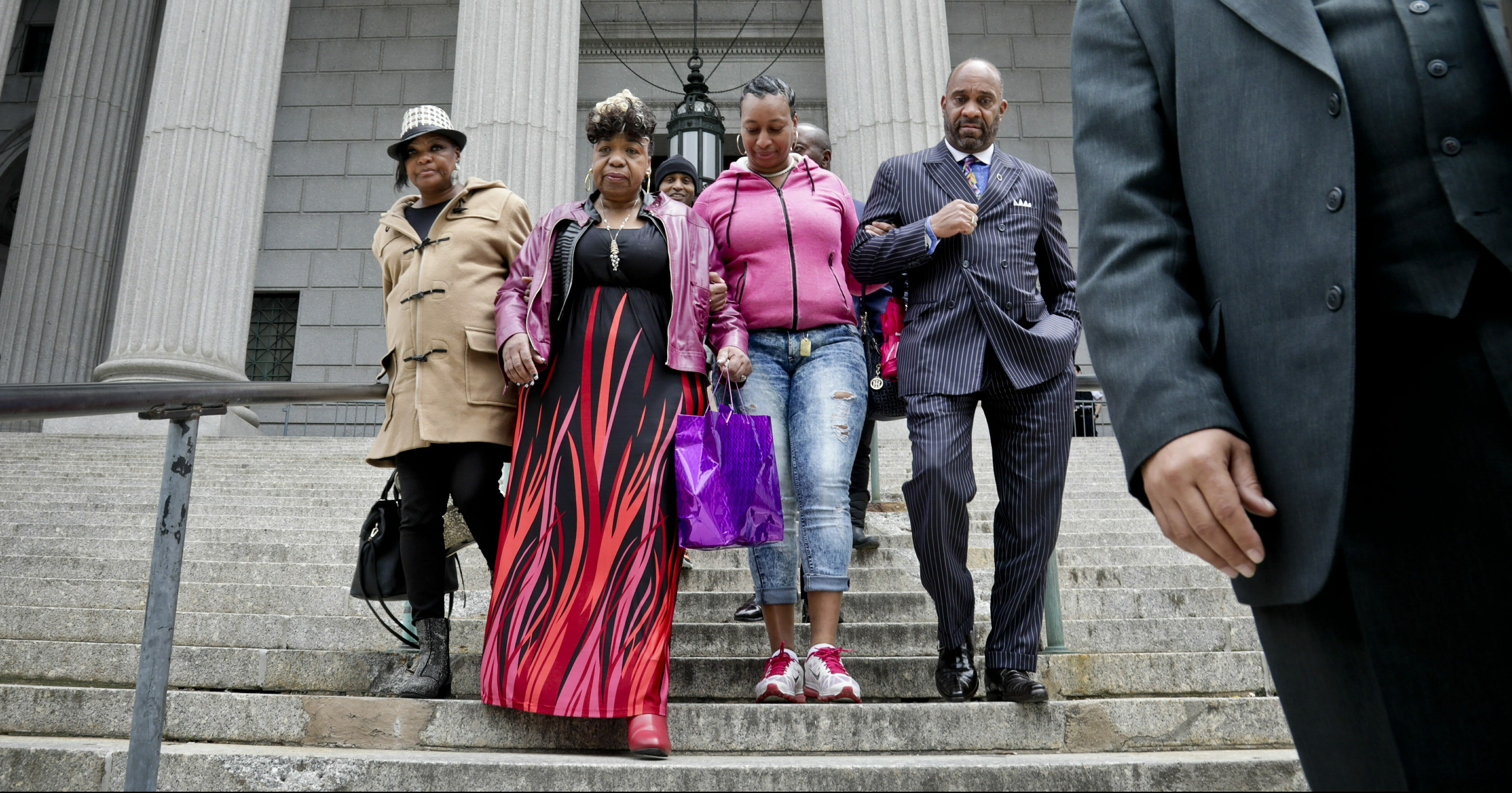 Gwen Carr, second from left, mother of Eric Garner- an unarmed black man who died as he was being subdued in a chokehold by officer Daniel Pantaleo nearly five years ago, is escorted as she leaves court with family members Thursday May 9, 2019, in New York.