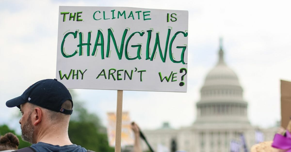 People attend the People's Climate March.
