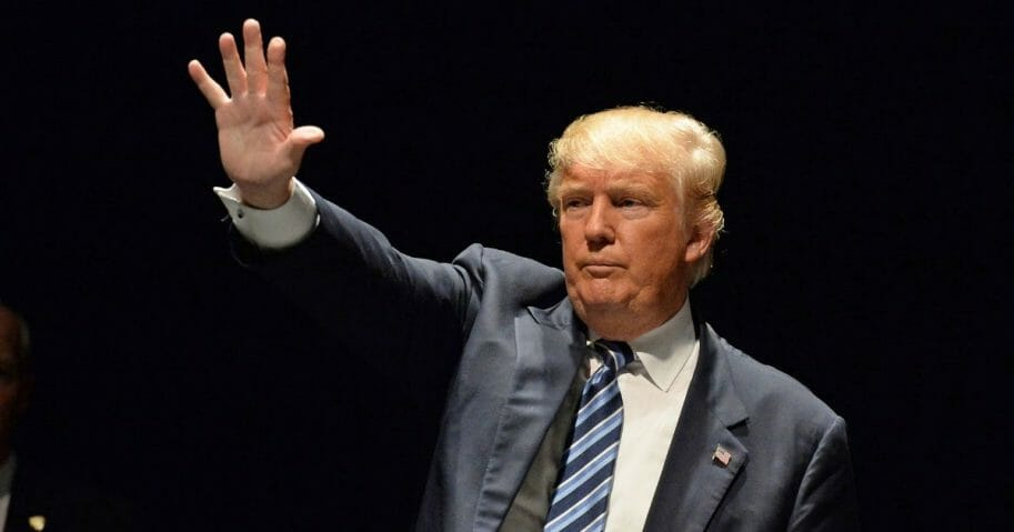 President Donald Trump waves to a crowd.