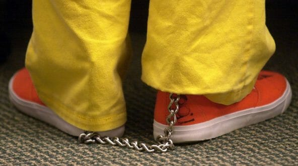 shackled shoes of a prison inmate