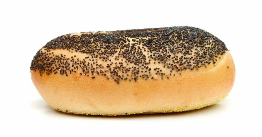 Bagel covered in poppy seeds.
