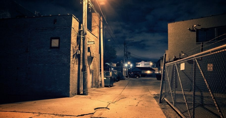 Urban alley at night.