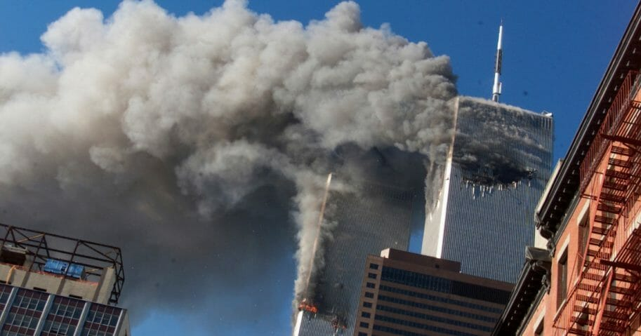 In this Sept. 11, 2001 file photo smoke rises from the burning twin towers of the World Trade Center after hijacked planes crashed into the towers, in New York City.