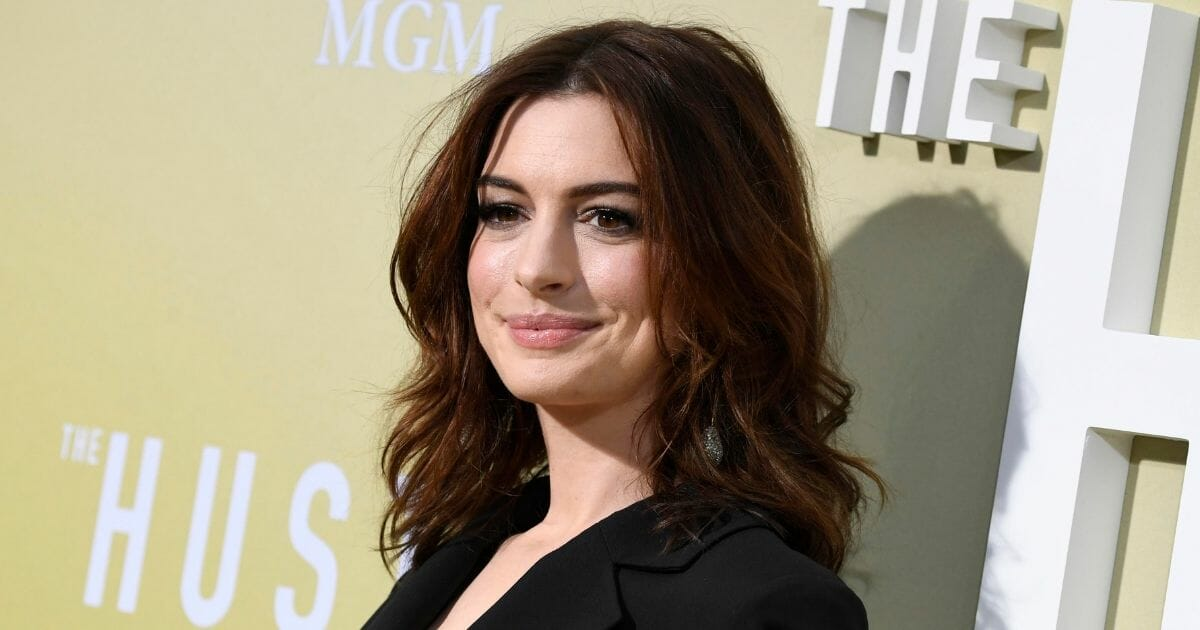 "Anne Hathaway attends the premiere of ""The Hustle."""