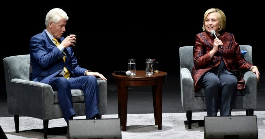 Bill and Hillary Clinton talk onstage at Park MGM on May 5, 2019, in Las Vegas, Nev.