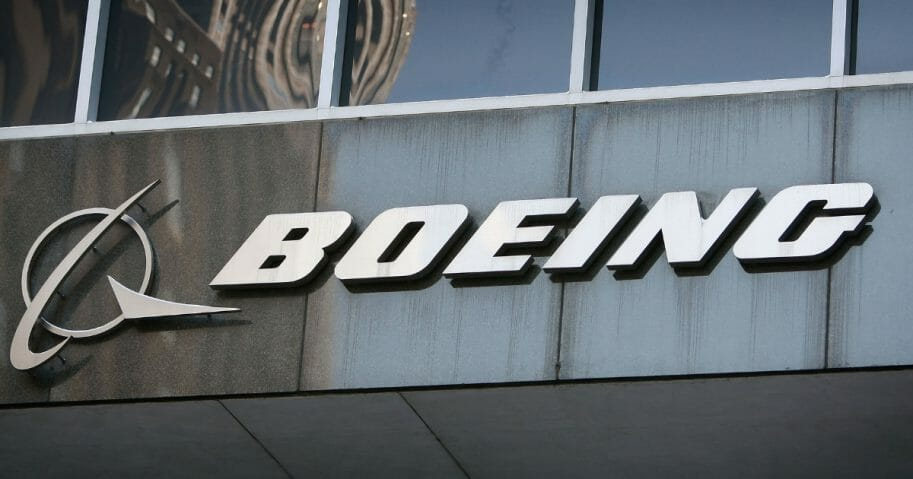 A sign hangs above the entrance to The Boeing Company's headquarters on January 28, 2009 in Chicago, Illinois.