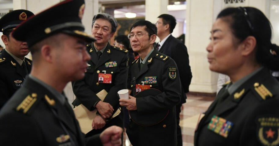 Chinese military delegates chat at the Great Hall of the People in Beijing on March 13, 2019.