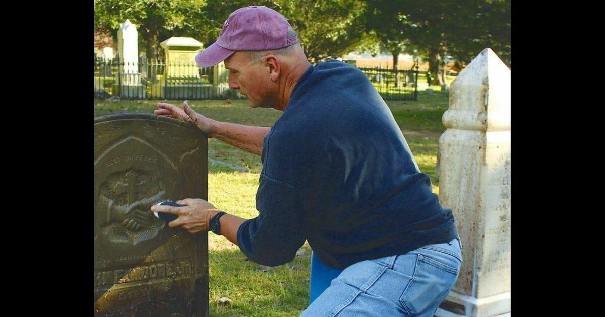 Man cleans headstones
