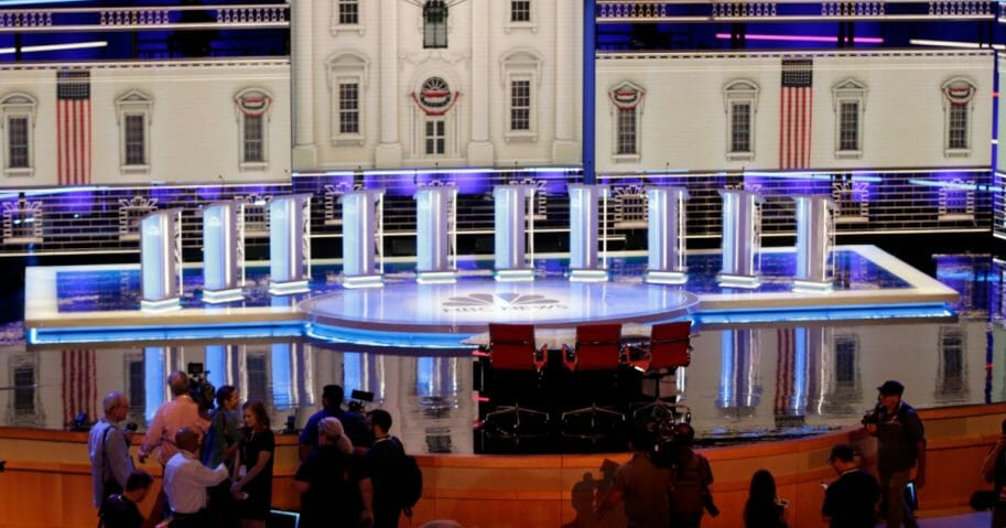 Members of the media gather for a walk-through of the stage set-up for the first Democratic presidential debate.