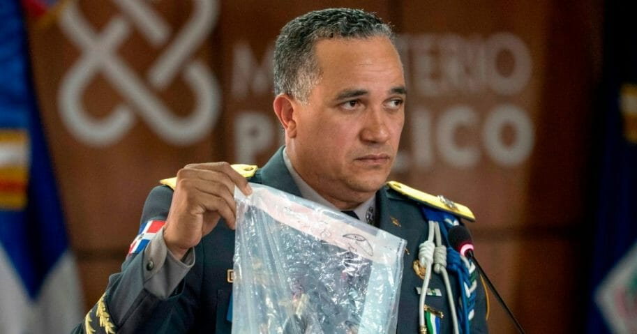 Dominican Republic's National Police Director Ney Aldrin Bautista Almonte shows evidence at a news conference June 12, 2019, in regard to the shooting of ex-Major League Baseball player David Ortiz in Santo Domingo.
