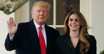 President Donald Trump poses with former communications director Hope Hicks shortly before making his way to board Marine One on the South Lawn and departing from the White House on March 29, 2018.