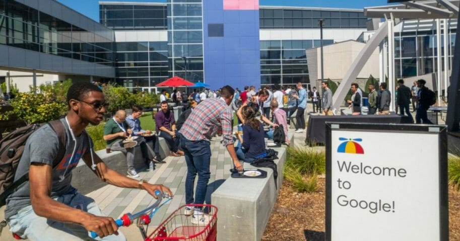 Google employees working outside the company's Googleplex headquarters in Mountain View, Calif.