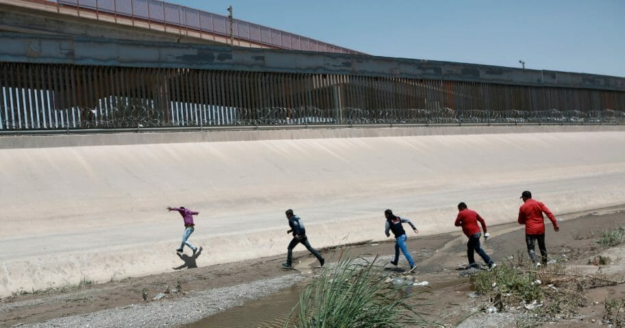 Illegal immigrants cross the Rio Bravo on the U.S.-Mexico border.