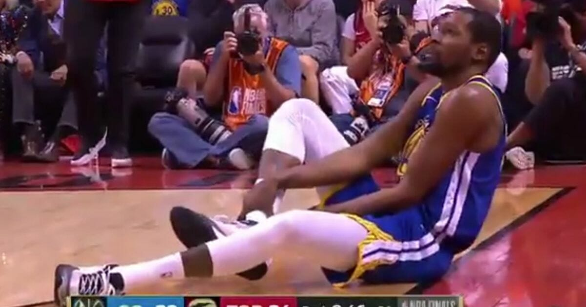 Kevin Durant of the Golden State Warriors stops to nurse his latest injury during the NBA Finals on Monday, June 10, 2019, in Toronto.