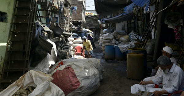 This picture taken on March 7, 2019 shows sacks of plastic waste arranged outside a factory in Dharavi, Asia's largest slum in Mumbai.