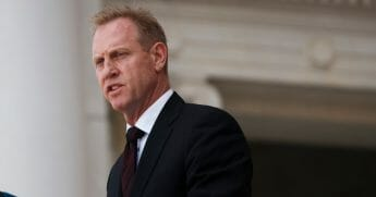 Acting Secretary of Defense Patrick Shanahan delivers remarks during a Memorial Day ceremony at Arlington National Cemetery on May 27, 2019 in Arlington, Virginia.