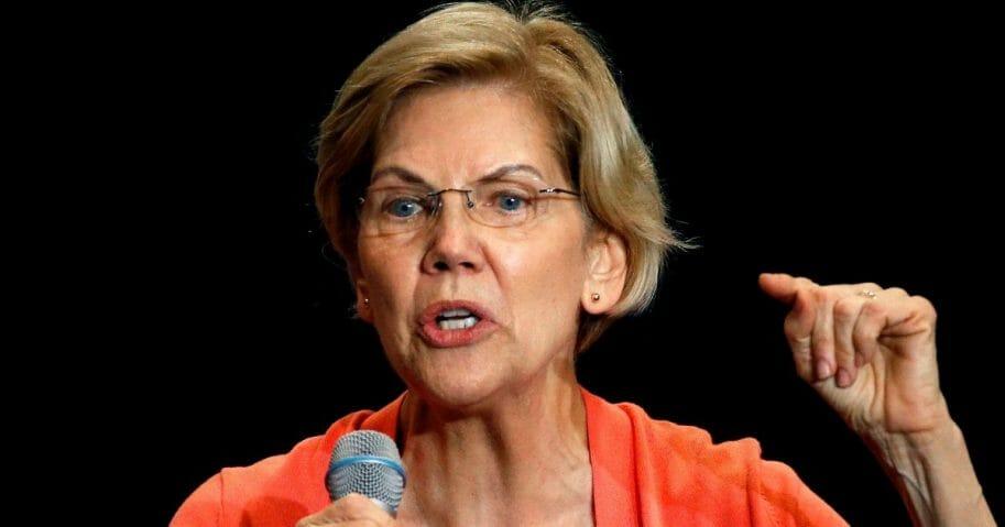 Sen. Elizabeth Warren gestures during a town hall meeting on June 25, 2019, in Miami, Fla.