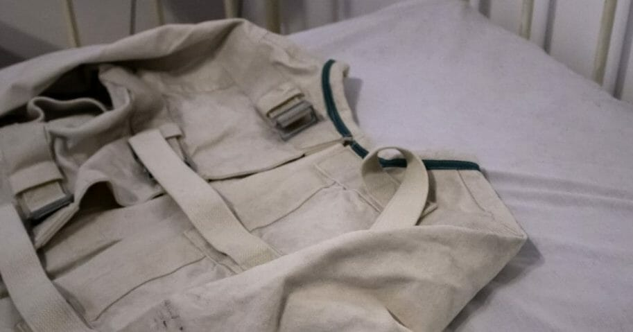 A straitjacket on a psychiatric hospital bed