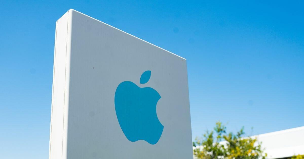 Apple logo on a sign near the company's headquarters in Cupertino, California