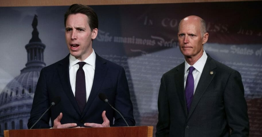 U.S. Sen. Josh Hawley of Missouri, left, speaks as Sen. Rick Scott of Florida, right, listens during a news conference at the U.S. Capitol April 2, 2019, in Washington.