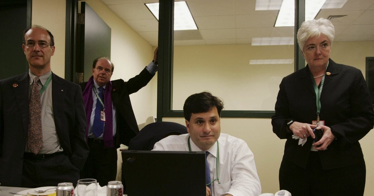 Foreground from left, Jonathan Winer, Bob Shrum and Mary Beth Cahill, members of Democratic presidential candidate John Kerry's campaign staff.