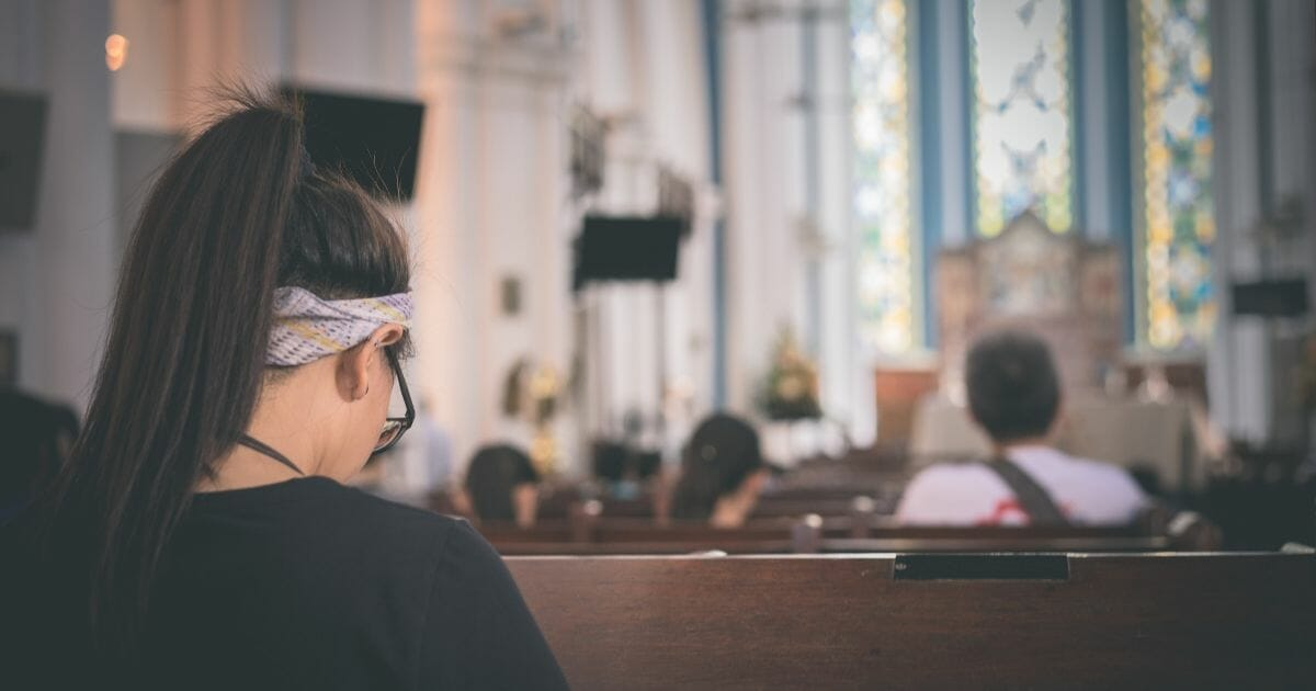 Girl in church pews