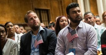 Immigrants participate in a naturalization ceremony to officially become U.S. citizens.