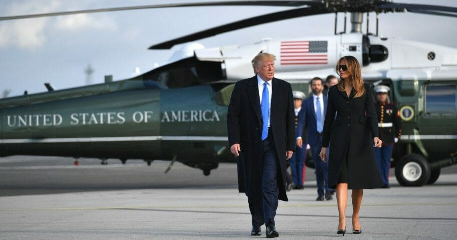 President Donald Trump and first lady Melania Trump make their way to board Air Force One.