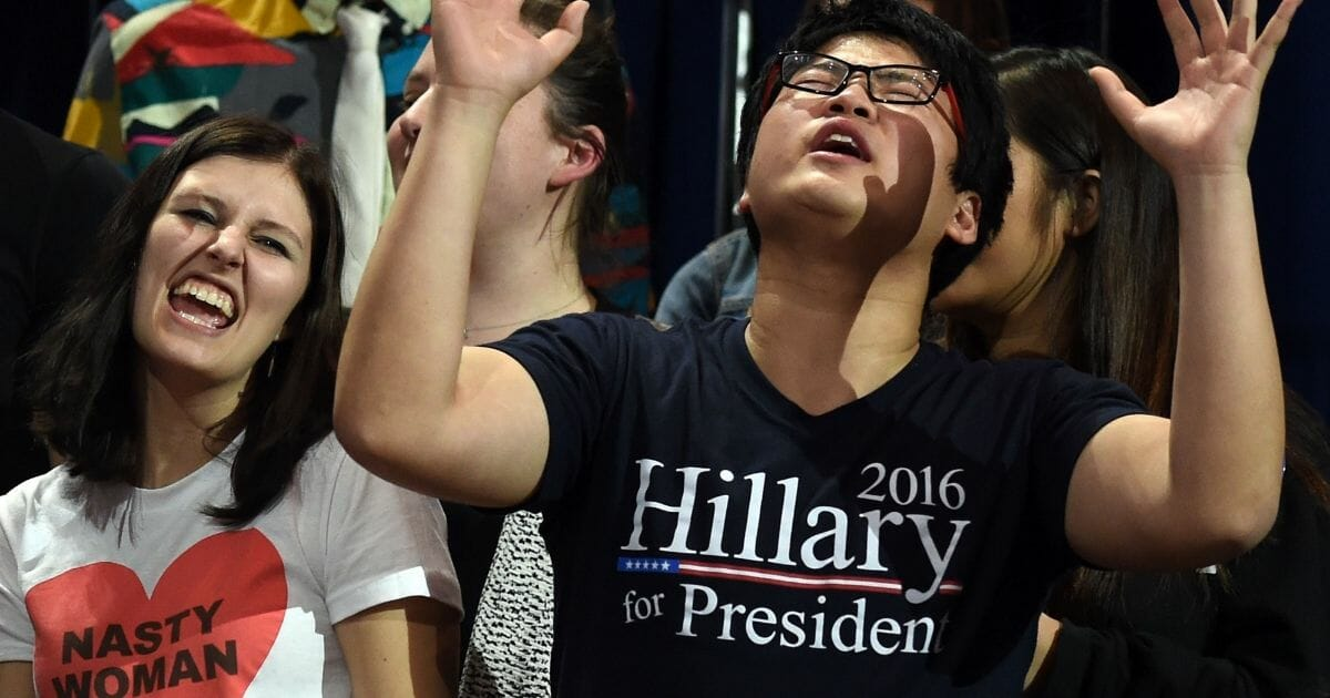 People sing as they watch elections returns during election night at the Jacob K. Javits Convention Center in New York on November 8, 2016.