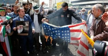 Iranian demonstrators burn a makeshift US flag during a rally in the capital Tehran, on May 10 2019.