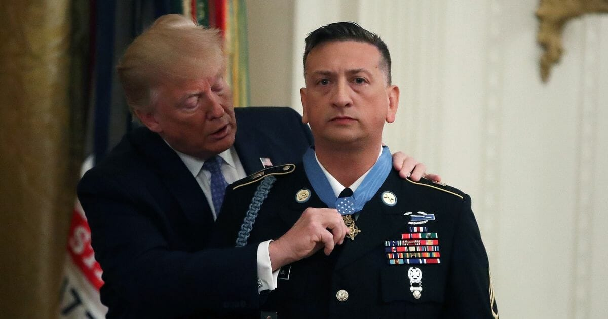 U.S. President Donald Trump presents the Medal of Honor the U.S. Army Staff Sgt. David Bellavia Ret., during a ceremony in the East Room at the White House, on June 25, 2019, in Washington, D.C.