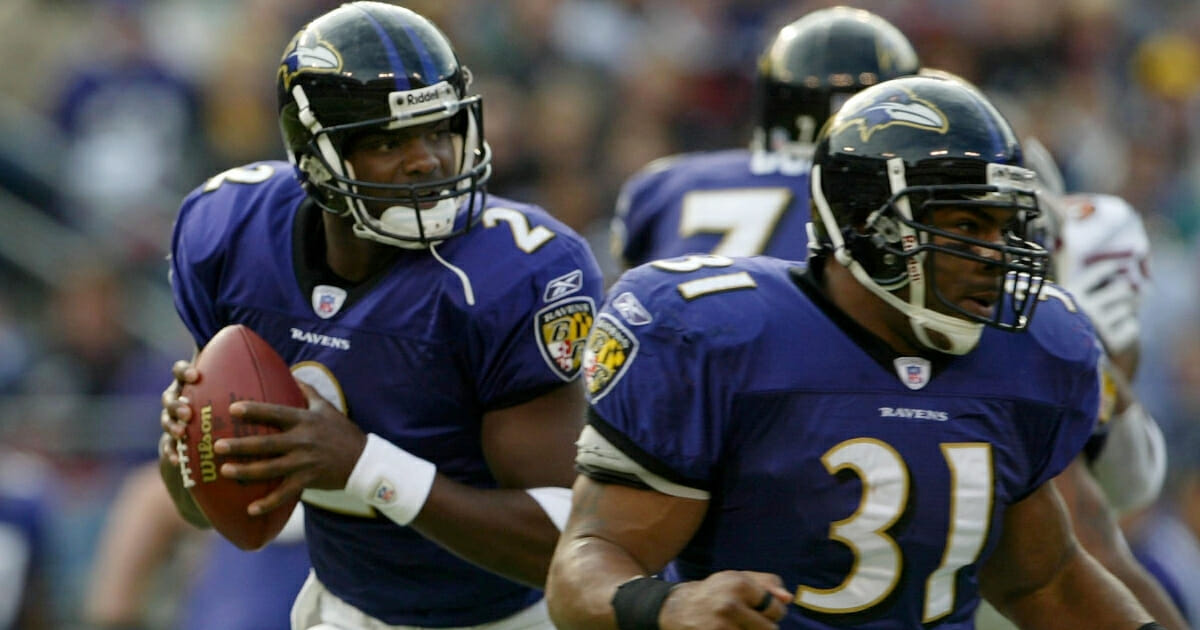 Anthony Wright drops back and looks for a receiver as Jamal Lewis provides protection for the Baltimore Ravens.