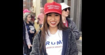 Beauty queen in a MAGA hat
